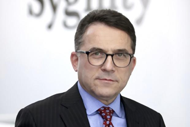 Janusz R. Guy - prezes zarządu, Sygnity - sylwetka osoby
